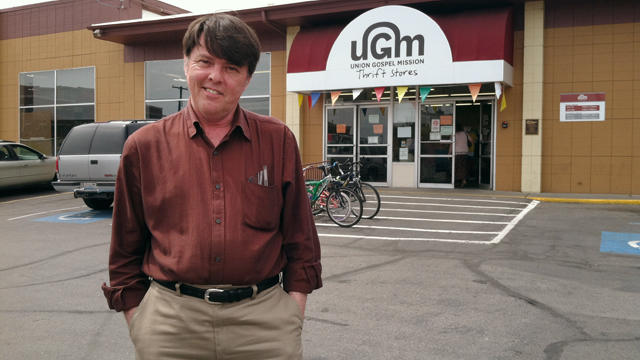 Robert Lindstrom in front of Thrift Store