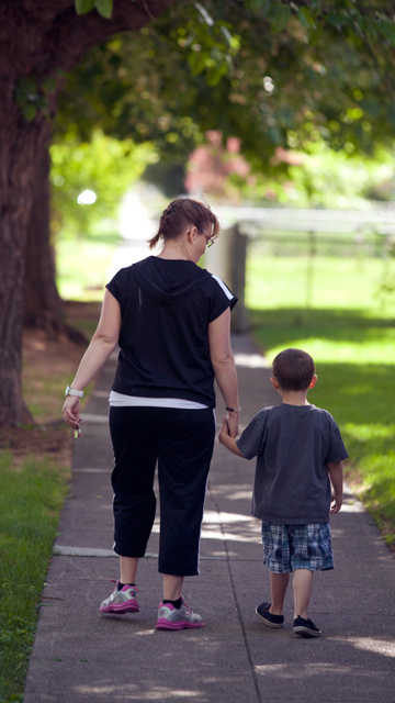 Resident Becca taking a walk with her son