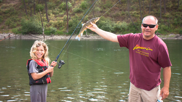 Camp Director with little girl who caught a fish