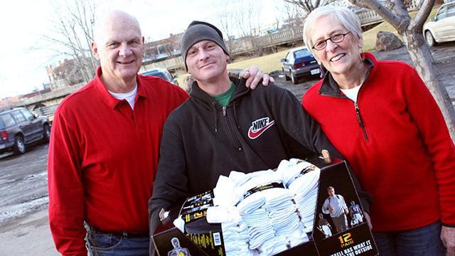 couple donating box of socks