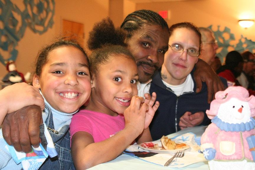 homeless family eating at shelter