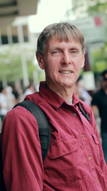 Paul walk down the busy streets of Spokane