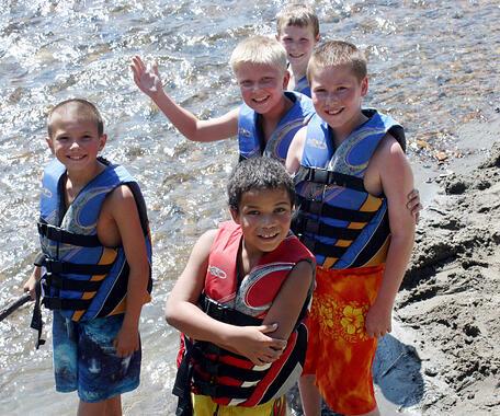 boys in creek