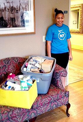 high school girl donates toiletries to homeless