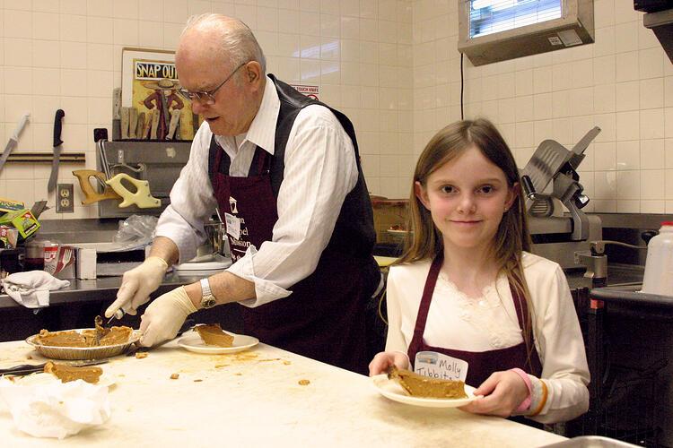 older_man_and_girl_serving
