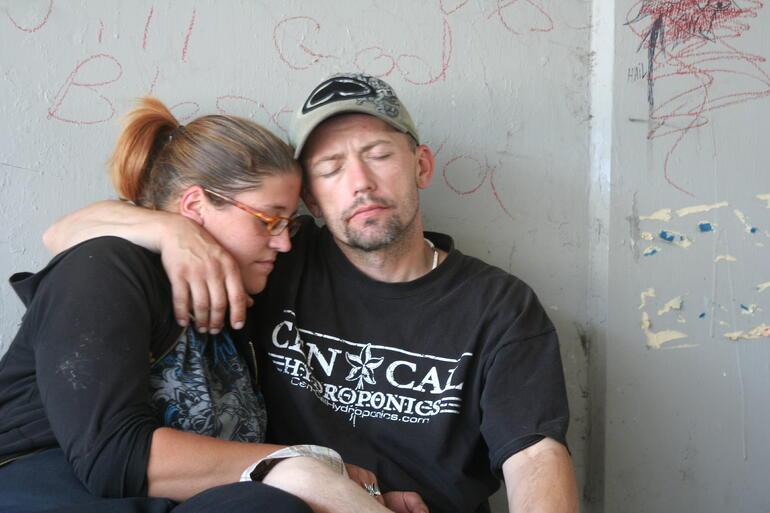 homeless couple struggling