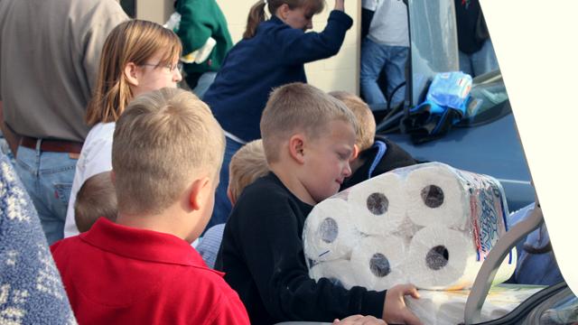 kids doing paper drive