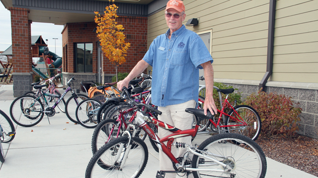 Volunteer Bob fixes bikes