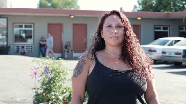 Faith standing outside the Crisis Shelter