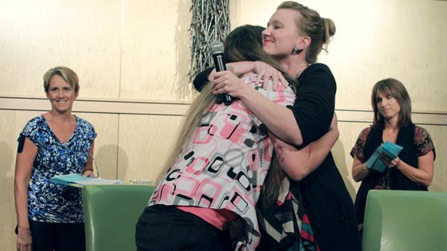 Jillian hugging woman