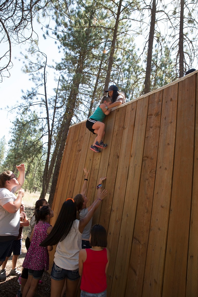 """""""The Wall"""" is a trust-building exercise at UGM Camp."""