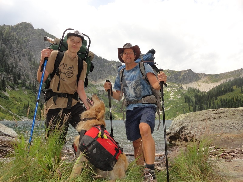 UGM Director of Volunteers Greg Barclay enjoys a backpacking trip with his son, Cameron, and dog Ransom.