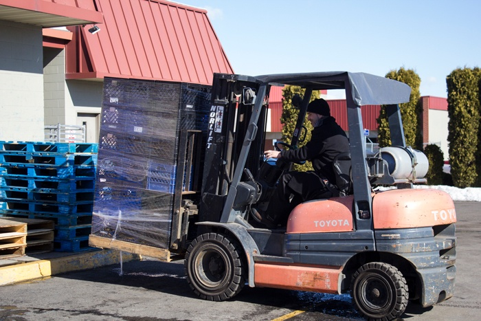 Driving the forklift is just one piece of what it takes to feed the hungry at UGM.