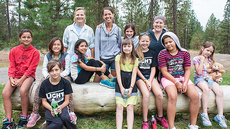 """Jaylissa (in stripes and hood) was a """"shy little kid"""" before connecting with cabin mates and counselors at UGM Camp."""