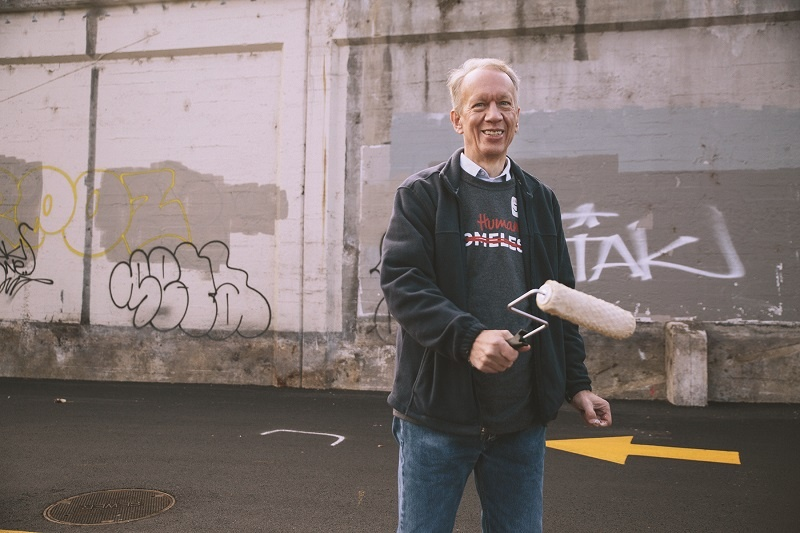 Jim Illback served among other volunteers on World Homeless Day, and regularly serves at UGM to help the homeless.