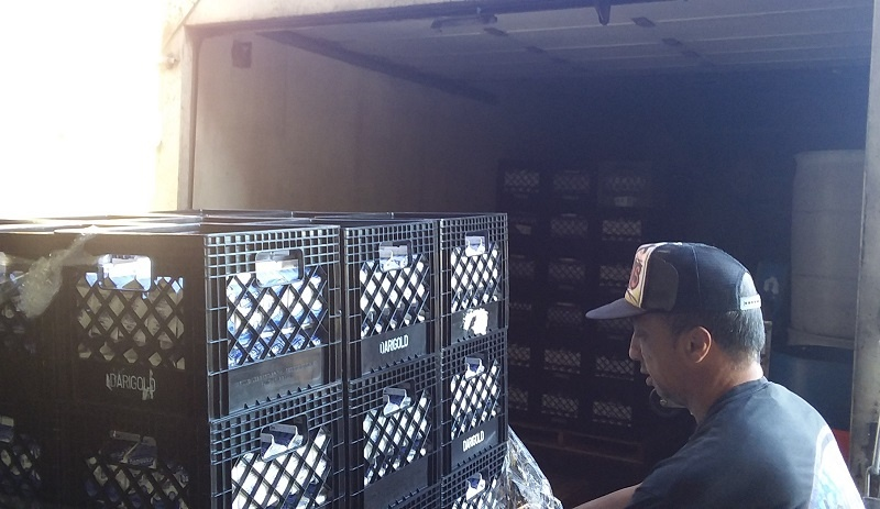 Rick helps load milk donated by Darigold,  one of UGM's food partners, into our truck.