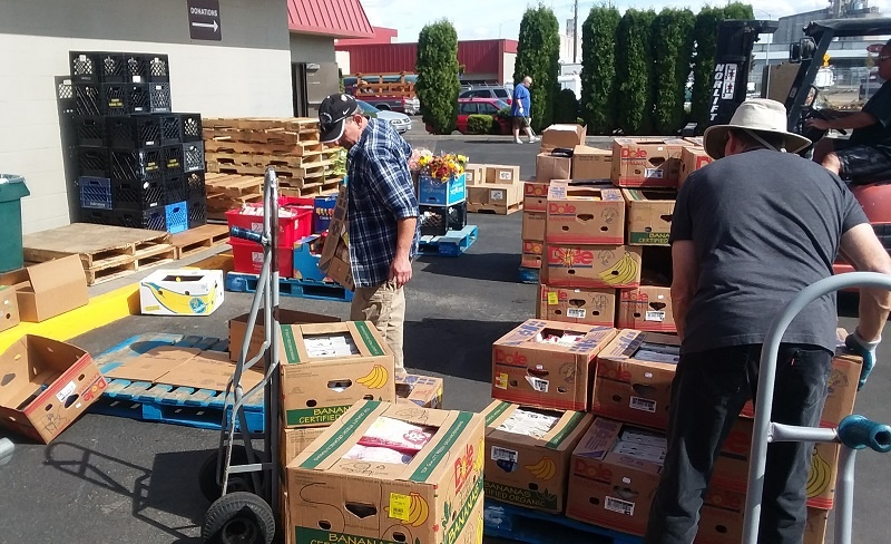UGM warehouse crew includes residents, volunteers, and staff. All hands were on deck to sort the donations from Wal-Mart, one of UGM's food partners.