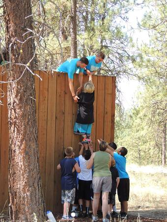 The challenge course at UGM Camp includes trust exercises and team-building.